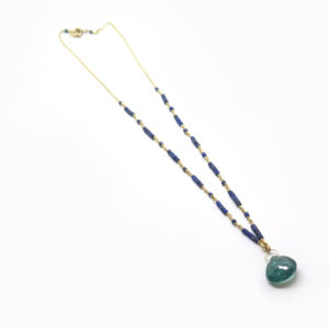 Collier or et tourmaline bleue