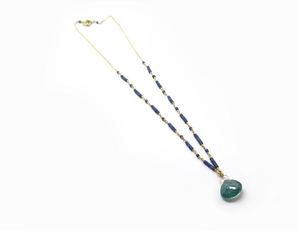 Collier or et tourmaline bleue